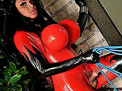 Latex clad shemale fucking her lover