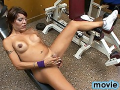 Sexy tgirl Belen playing with herself in the gym