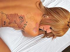 Tattooed tranny sucks and gets fucked